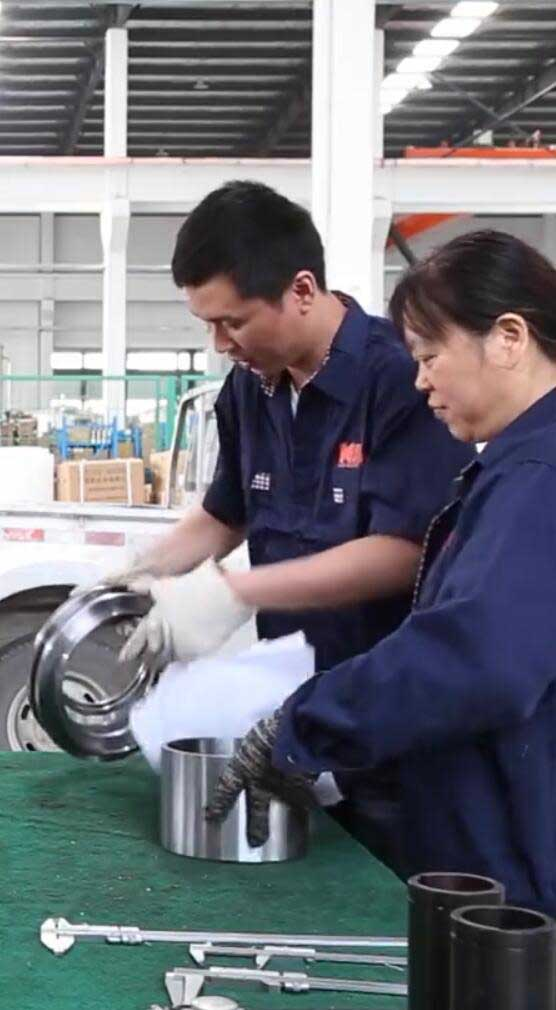 Engineer of Steplead working on assembly line for bottled water filling machine