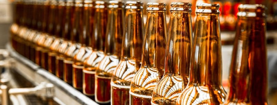 Beer Bottles Filling On The Conveyor