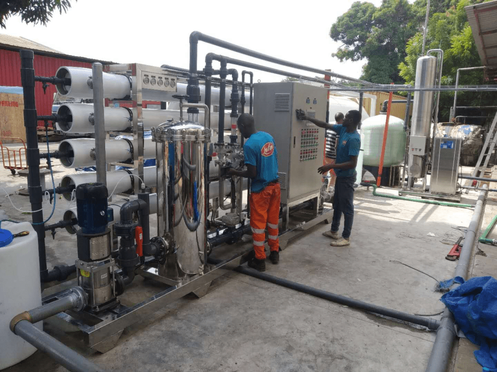 customer technician learning operation of RO water treatment system